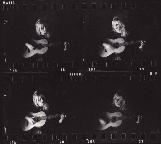Brigitte Bardot, playing the guitar