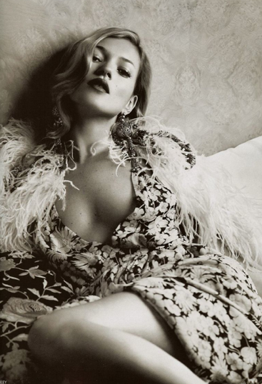 Kate Moss, flower print dress and feather boa, 1930s style, Lachlan Bailey, Vogue December 2007