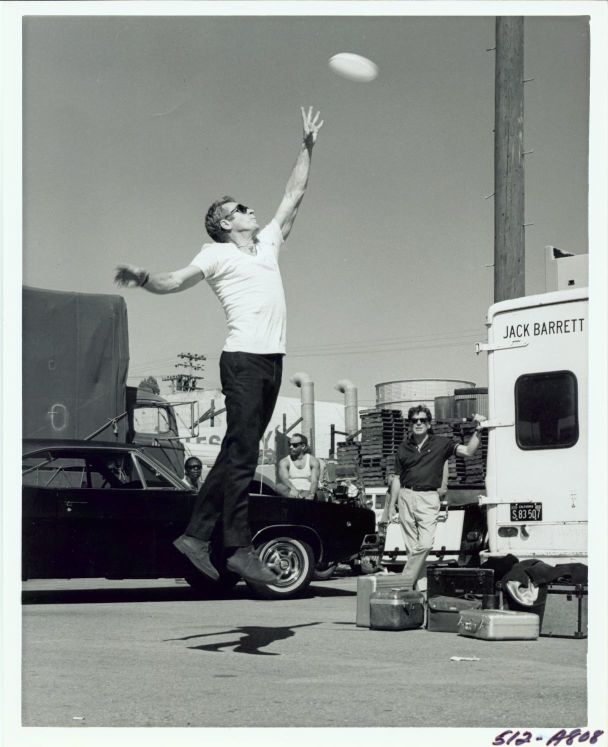 Steve McQueen playing basketball