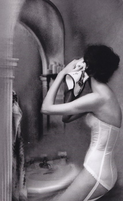 Lillian Bassman, woman looking in the mirror, white basque