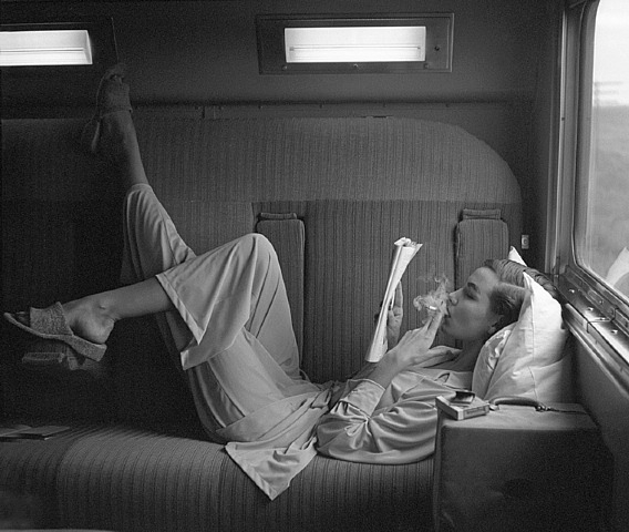 Lillian Bassman, smoking on the train, pyjamas