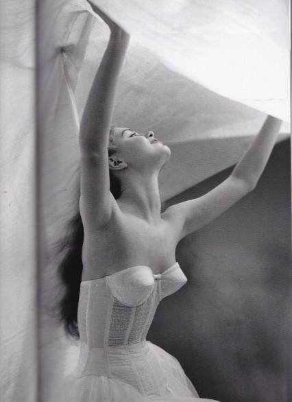 Lillian Bassman, Under the sheet, white basque