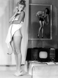 Young pin up Marilyn in a towel and tan lines